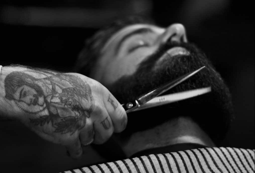 Barber cuts beard