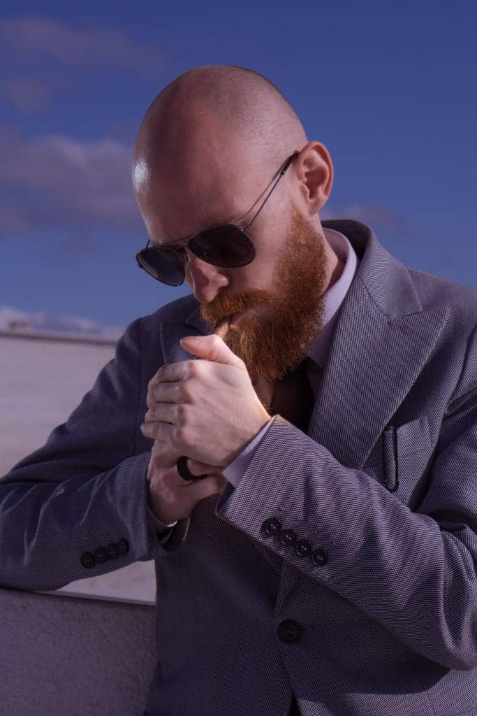 Man with bald head, beard and cigarette