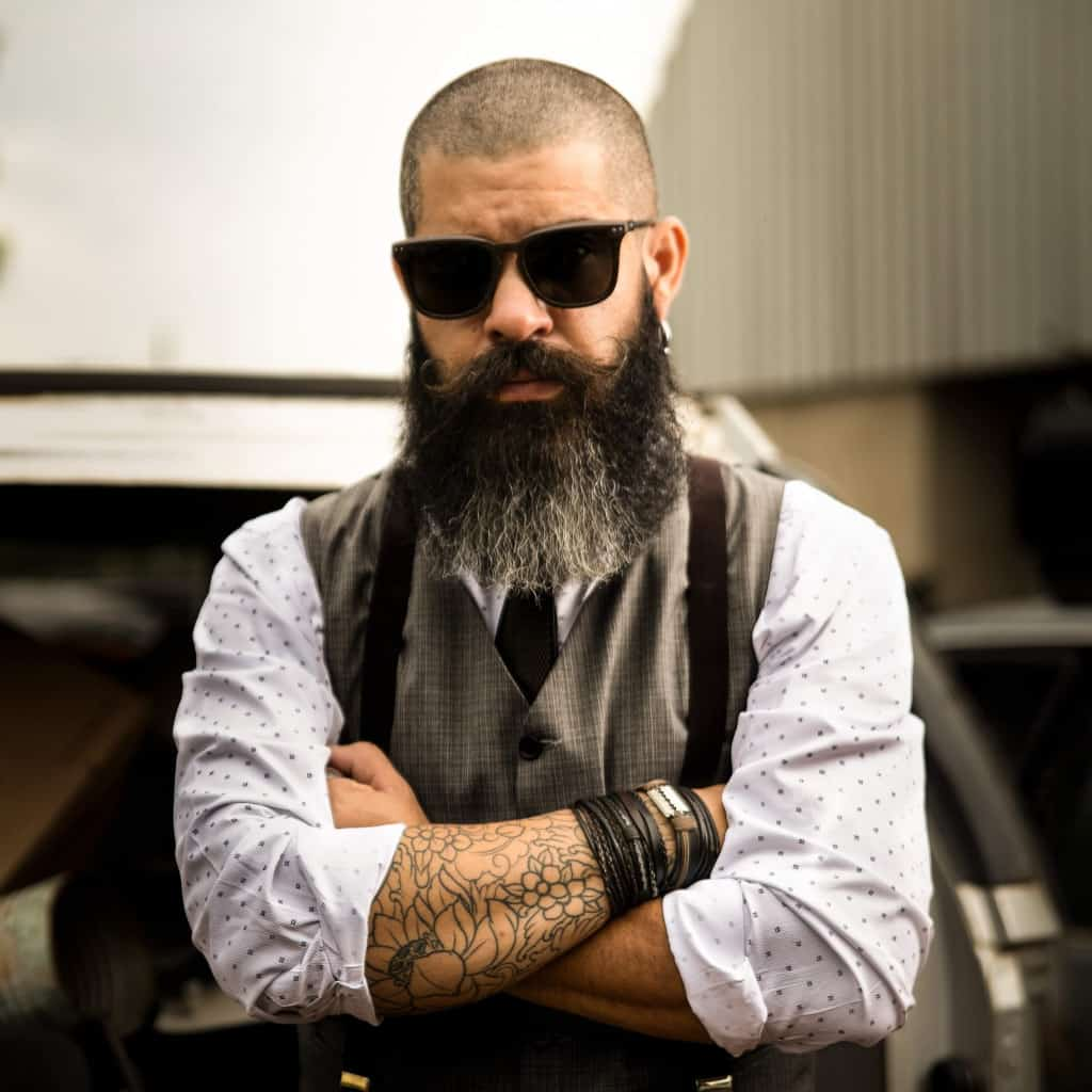 Cool man with bald head and full beard