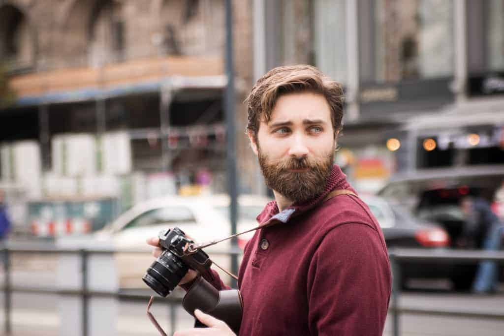 Man with beard and camera in the city