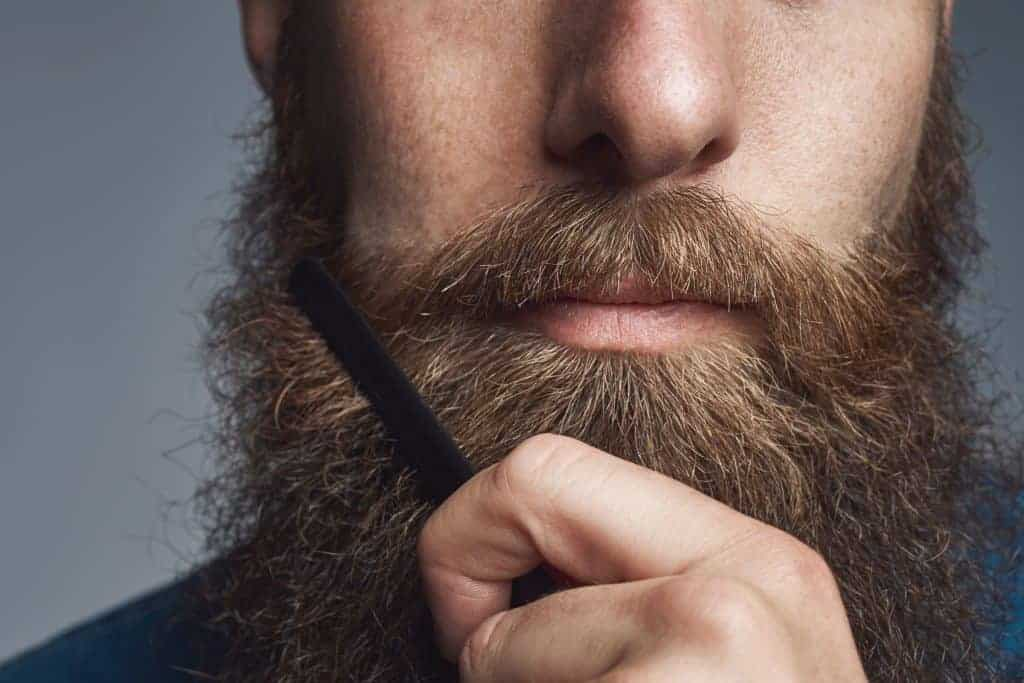 Man combs beard
