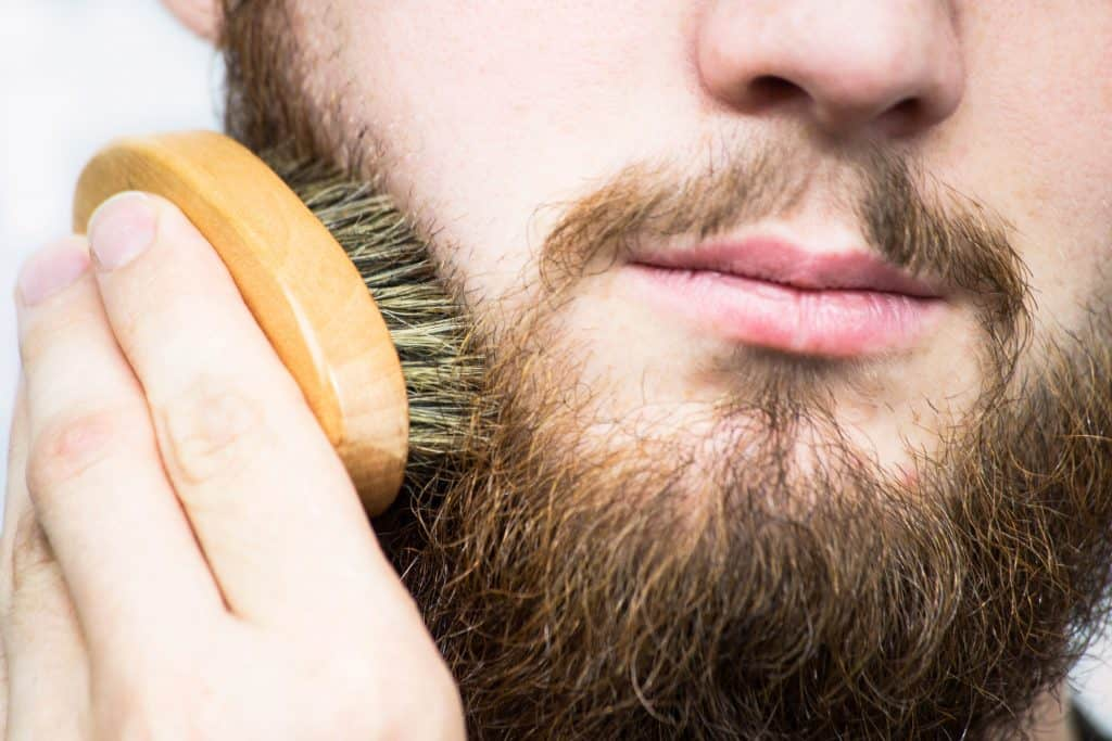 Man brushes beard